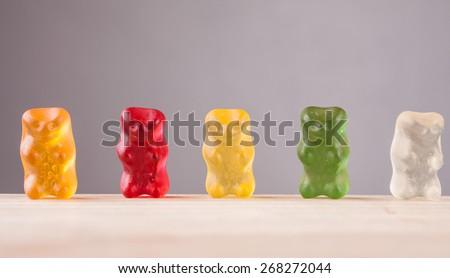 gummi bears, mint on a wooden background - stock photo