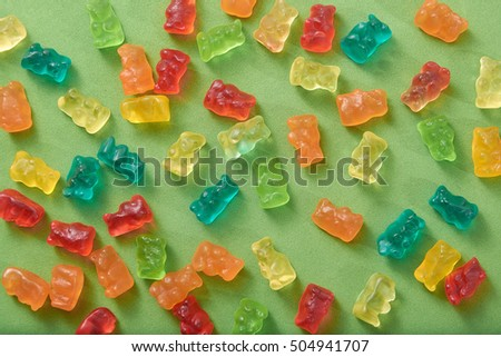 gummy bear lay on green surface