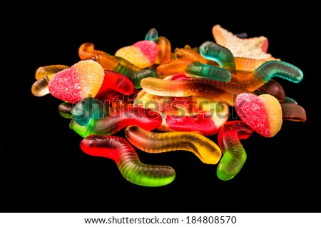 gummy bears candy assorted on a dark background - stock photo