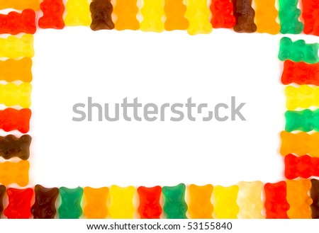 Gummy bears frame with white empty space in middle. - stock photo