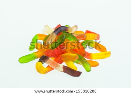 Gummy worms candy close up over white background - stock photo
