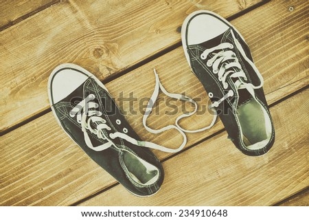 Gumshoes on a wooden floor