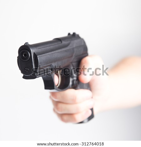 Gun aiming into the camera - stock photo