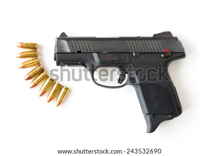 Gun and bullet on white background. - stock photo
