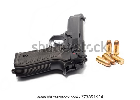 gun and bullets isolated on white - stock photo
