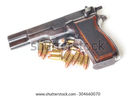 Gun and cartridges isolated on white background - stock photo
