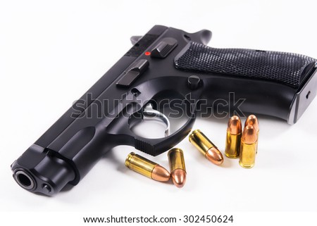 Gun and group of Bullets or Ammunition on White background - stock photo