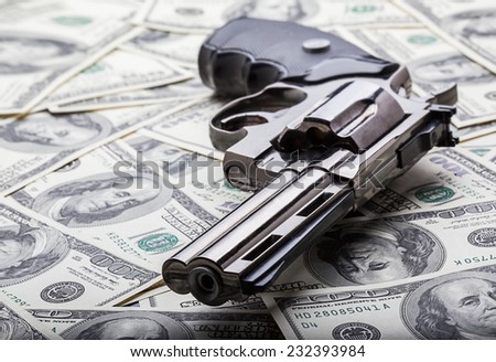 Gun and money concept - stock photo