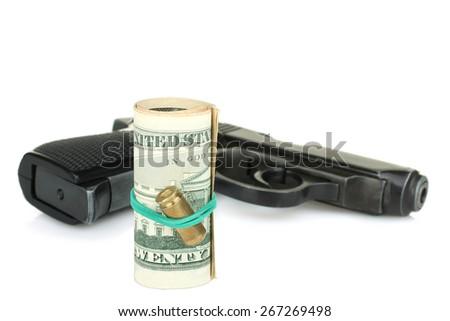 gun and money isolated - stock photo