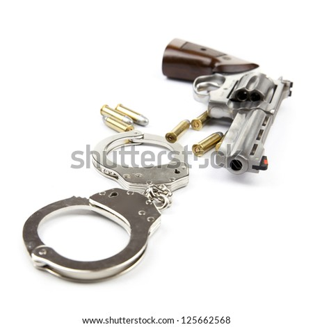 Gun, bullets and handcuffs isolated on white background - stock photo