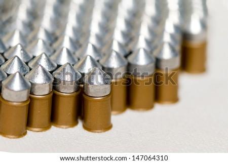 Gun bullets over white background - stock photo