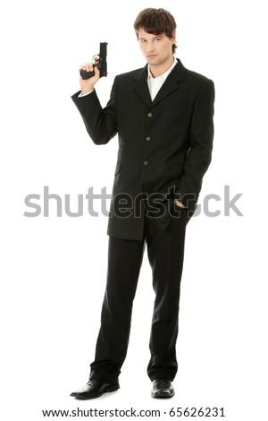 Gun control concept - businessman with handgun, isolated on white - stock photo