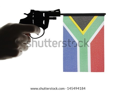 Gun crime concept of hand pistol showing the flag of south africa - stock photo