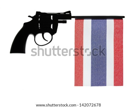 Gun crime concept of hand pistol showing the flag of thailand - stock photo