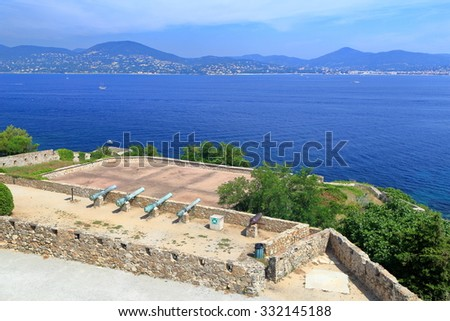 Gun deck with bronze canons aimed to the sea inside Saint Tropez fortress, French Riviera, France - stock photo