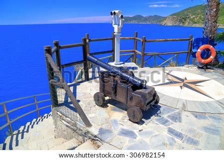 Gun deck with old canon and telescope above the sea in Manarola, Cinque Terre, Italy - stock photo