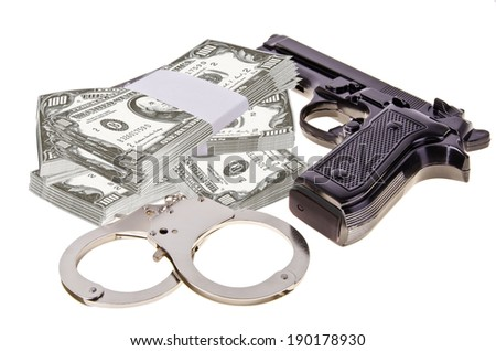 Gun, handcuffs and money isolated on white background.