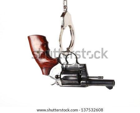 Gun hanging Handcuffs on white background - stock photo
