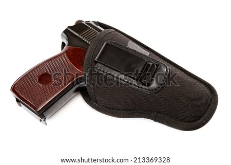 Gun in a holster isolated on white background. - stock photo