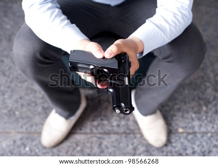 gun in businessman hand - stock photo