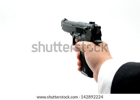 Gun in businessman's hand - stock photo