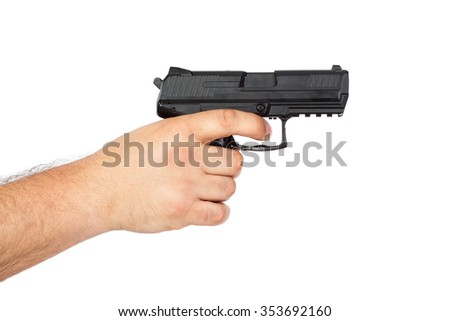 Gun in the hand isolated on white background - stock photo