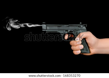 gun in the hand of a man on an isolated background - stock photo