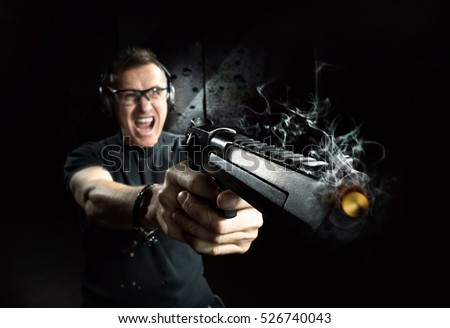 Gun in the hands of the man in a headphones