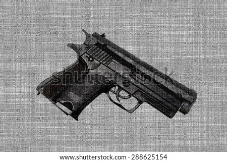 Gun isolated on fabric background - stock photo
