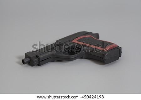 Gun isolated on gray background - stock photo
