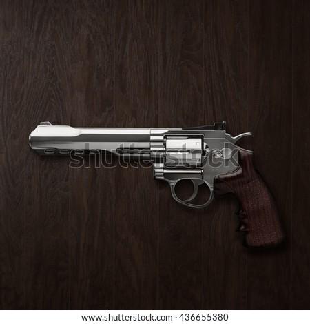 Gun Magnum wood background - stock photo