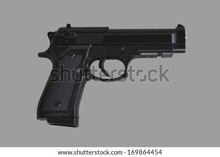 gun on gray background, isolated - stock photo