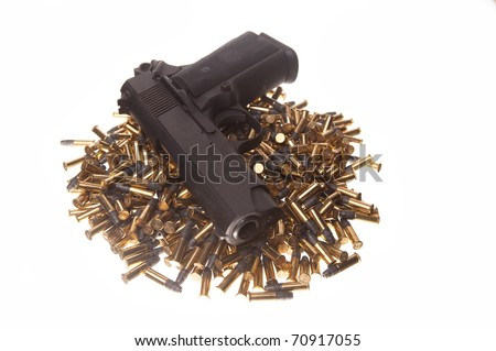 gun on pile of bullets - stock photo