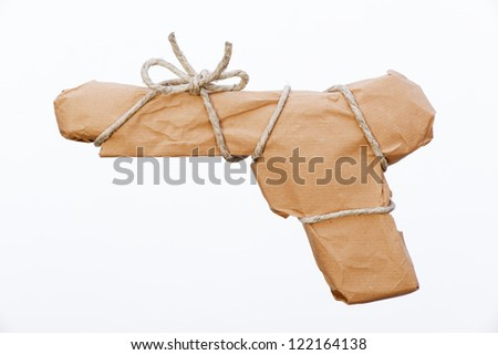 gun packed with paper and twine for shipping - stock photo