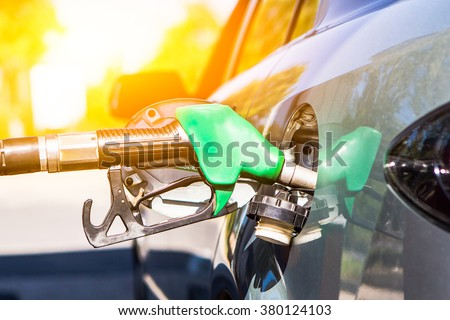 Gun petrol in the tank to fill. Car refueling concept.