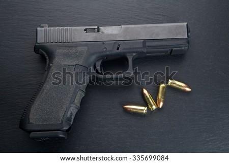 Gun pistol on black background - stock photo
