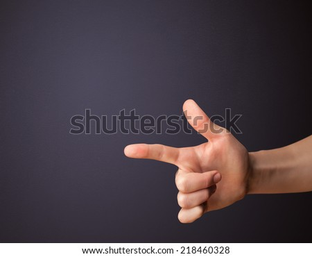 Gun shaped man hand with empty space - stock photo