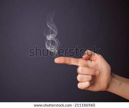 Gun shaped man hand with smoke - stock photo