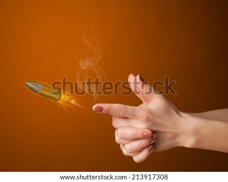 Gun shaped woman hand with bullet coming out of it - stock photo