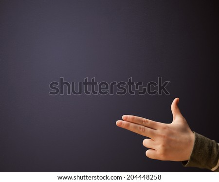 Gun shaped woman hand with empty space