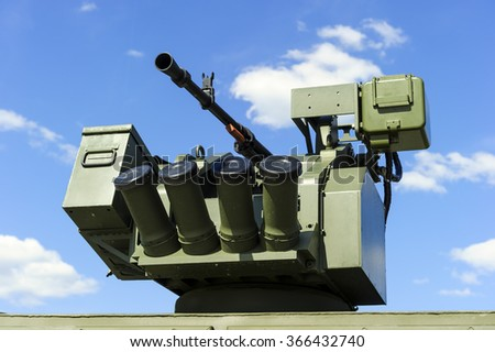Gun turret with grenade launcher of military offroader vehicle, heavy machine gun, modern army industry  - stock photo
