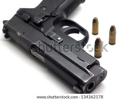 Gun with ammunition on white background - stock photo