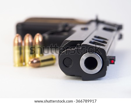 Gun with bullets. Isolated. Close up.