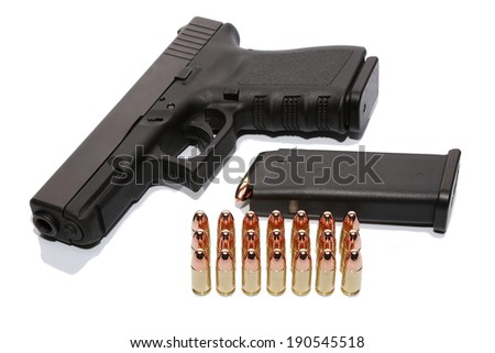 Gun with magazine and ammo on white background