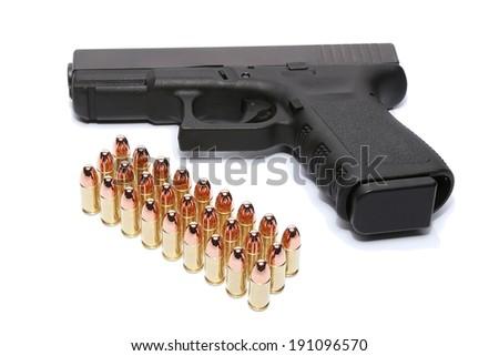 Gun with magazine and ammo on white background - stock photo