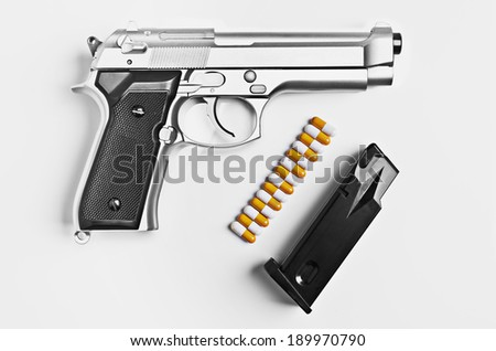 Gun with pills for bullets  - stock photo
