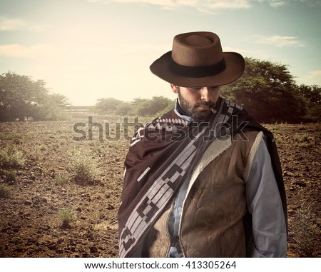 Gunfighter of the wild west with serious and angry expression. - stock photo