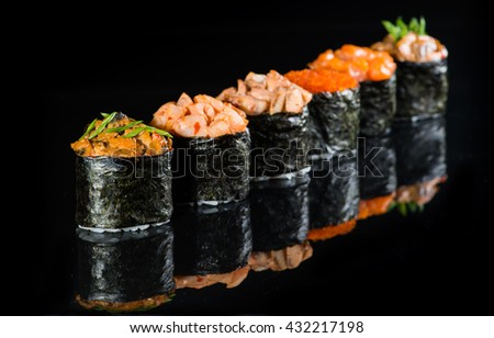 Gunkan sushi on a dark background, selective focus on the first object