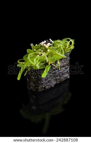 Gunkan sushi with seaweed on a black background - stock photo