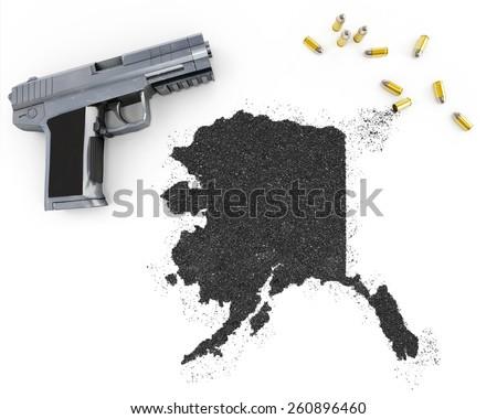 Gunpowder forming the shape of Alaska and a handgun.(series) - stock photo